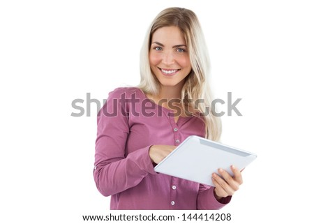 Smiling blonde woman using tablet pc on a white background