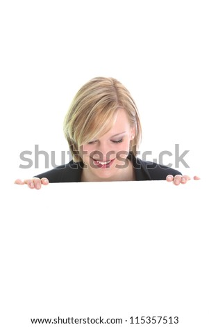 Smiling blonde woman with a blank white board looking down isolated on white