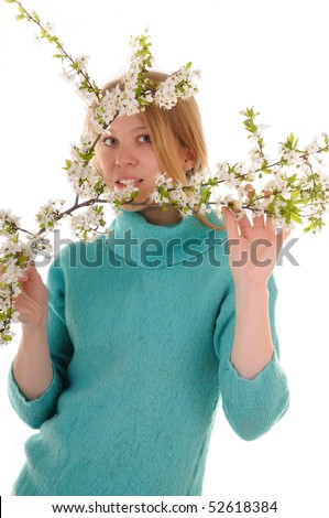Smiling blonde woman with spring white cherry flowers. Focus on woman's eyes. - stock photo