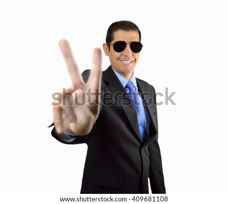 smiling bodyguard making the victory sign with his hand on white background - stock photo