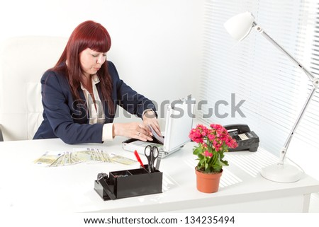 smiling book-keeper with a lot of money - stock photo
