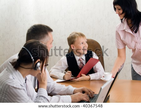 Smiling boss signing documents and his young secretary - stock photo