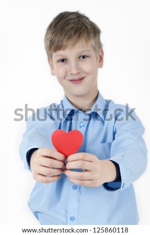 Smiling boy and red heart. Valentines Day concept. - stock photo