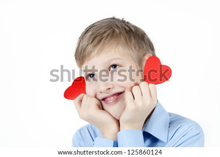 Smiling boy and red hearts. - stock photo
