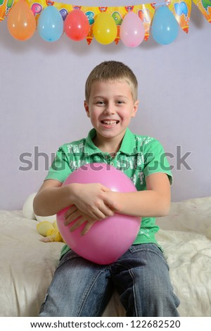 smiling boy at children party - stock photo