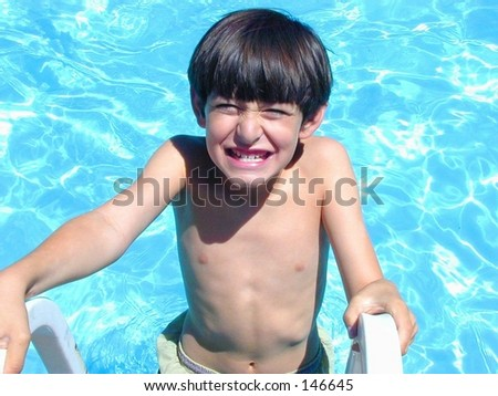 Smiling boy coming out of pool