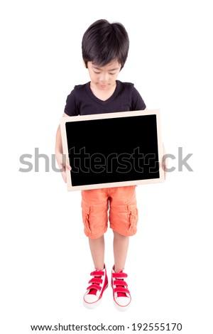 Smiling boy holding a blackboard over white background - stock photo