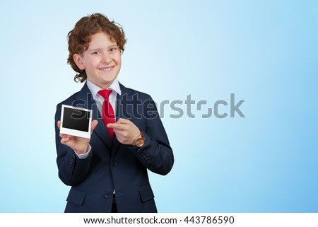 smiling boy holding blank paper