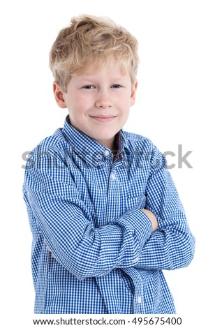 Smiling boy in blue checked shirt standing with arms folded, isolated on white background