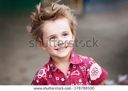 smiling boy in bright shirt - stock photo