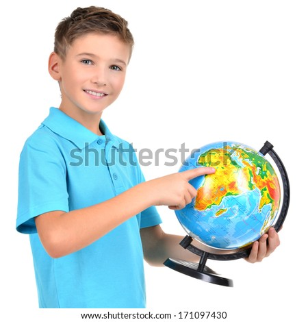 Smiling boy in casual  holding globe with in hands and points on it -  isolated on white - stock photo