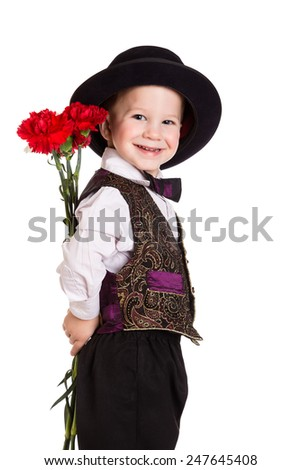 Smiling boy in hat hiding behind a bouquet of carnations, isolated on white - stock photo