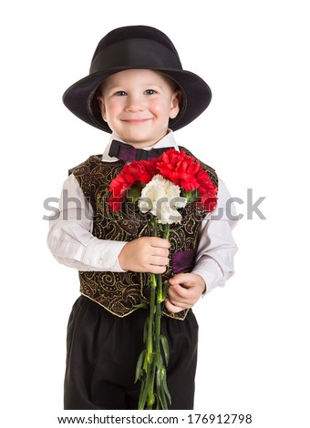Smiling boy in hat standing with a bouquet of carnations, isolated on white - stock photo