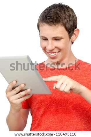 smiling boy in red t-shirt holding a tablet touch pad computer gadget.