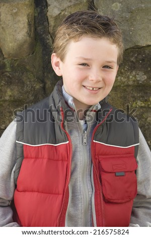 Smiling boy in vest