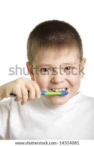 Smiling boy in white t-shirt brushing teeth isolated