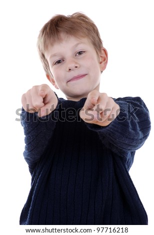 smiling boy is pointing at you