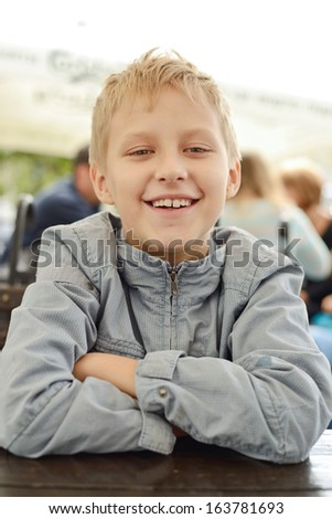 smiling boy looking at the camera