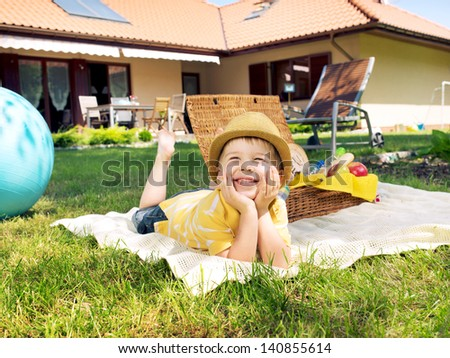 Smiling boy looking at the sky - stock photo