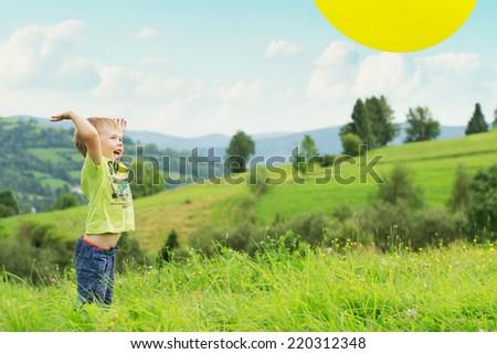 Smiling boy on blue sky background - stock photo