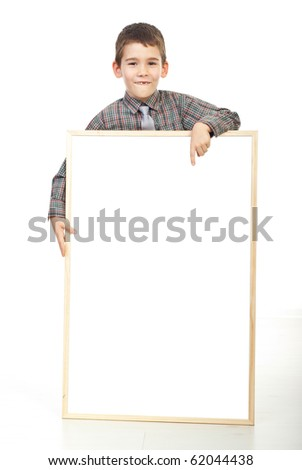 Smiling boy pointing to a blank banner isolated on white background - stock photo