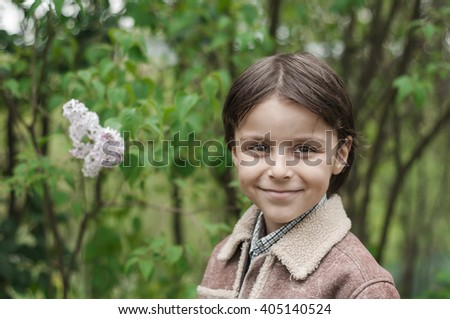 smiling boy,portrait of a sweet little boy with big black eyes  - stock photo