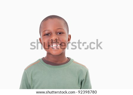 Smiling boy posing against a white a background - stock photo