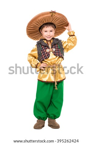Smiling boy posing in a mushroom costume. Isolated on white - stock photo