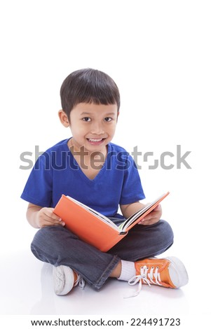 Smiling boy reading book
