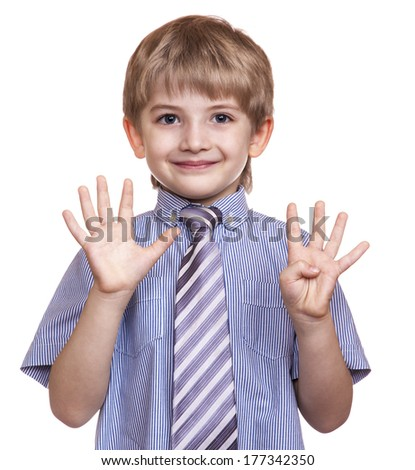 smiling boy shows nine fingers on a white background - stock photo