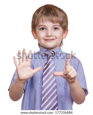 smiling boy shows seven fingers on a white background - stock photo