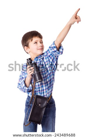 Smiling boy standing with spyglass and pointing up, isolated on white - stock photo