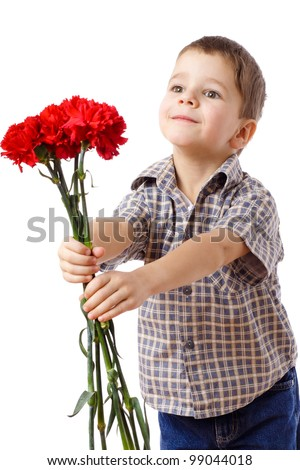 Smiling boy stretches forward a bouquet of red carnations, isolated on white - stock photo