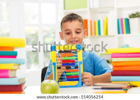 Smiling boy studying math