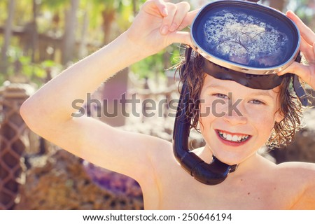 Smiling boy wearing mask and snorkel. Instagram effect - stock photo