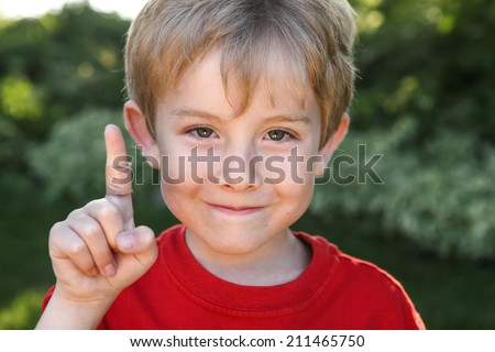Smiling boy with a bandaged finger - stock photo