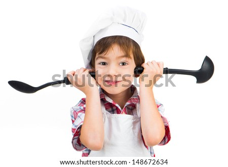 smiling boy with black spoons isolated - stock photo