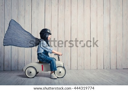 Smiling boy with car in studio - stock photo