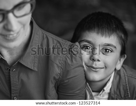 Smiling boy with his mom - stock photo