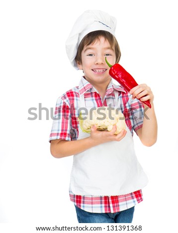 smiling boy with red pepper and cauliflower - stock photo