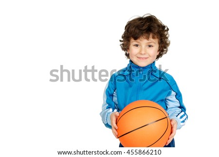 Smiling boy with six years old with a basket ball looking at camera - stock photo