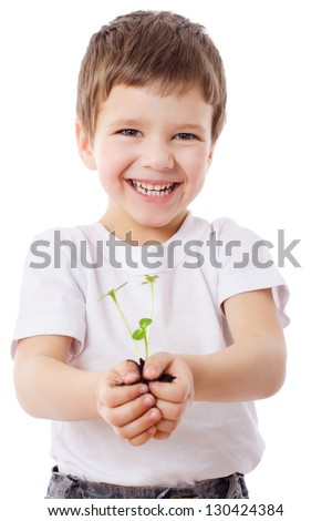 Smiling boy with sprouts in hands, isolated on white - stock photo