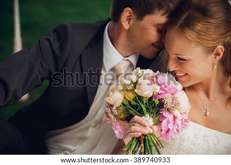 Smiling bride and groom at wedding day