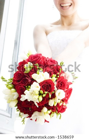 smiling bride tossing bouquet - stock photo