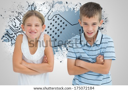 Smiling brother and sister posing together against splash on wall revealing circuit board - stock photo