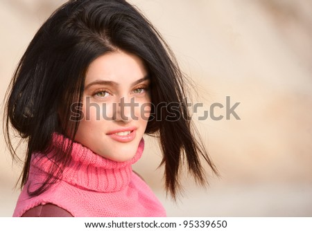 Smiling brunet girl in pink