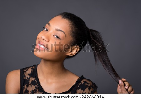 Smiling brunette brazilian woman close up portrait against dark background.  - stock photo