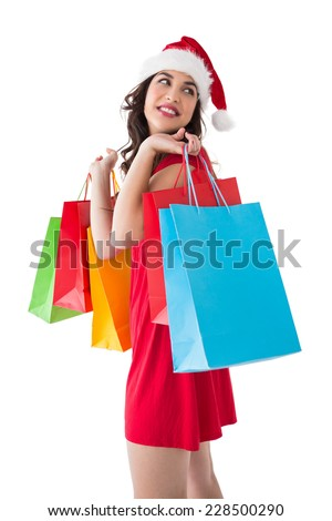 Smiling brunette holding shopping bags on white background