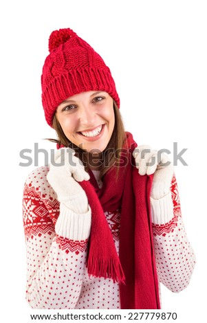 Smiling brunette in warm clothing looking at camera on white background
