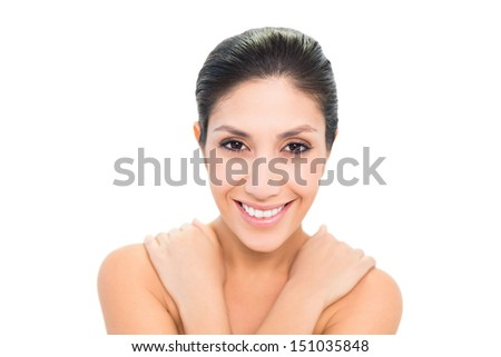 Smiling brunette with her hands on shoulders on white background - stock photo